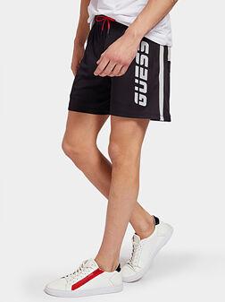 Kъс спортен панталон с лого надпис - 1
