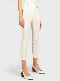 Slim trousers in beige color - 1