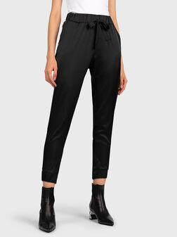 Jogger pants with leopard straps - 1