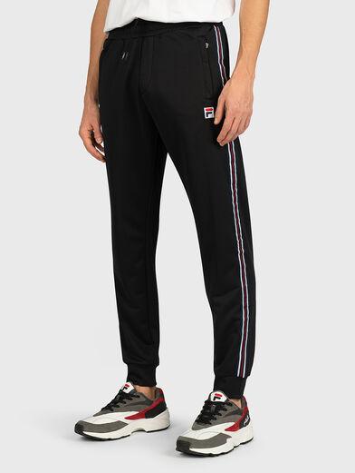 SALIH Track pants in black - 1