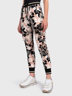 Cargo trousers with floral print - 1