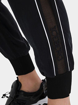Спортен панталон с мрежести детайли - 1