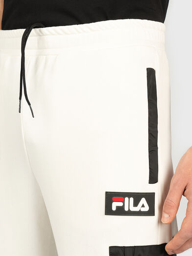 Sports pants with contrasting pocket - 1