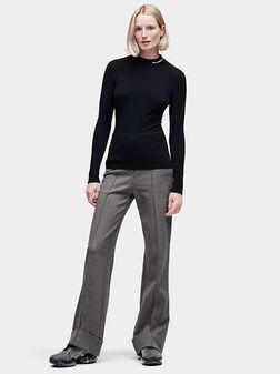 Mock neck sweater in black - 1