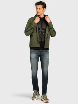 Green jacket with foldable hood - 1