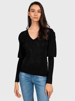 Black sweater with decorative studs - 1