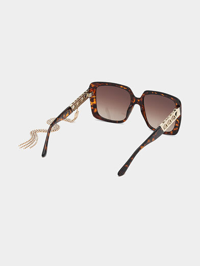 Sun glasses with brown frames and metal detail - 5