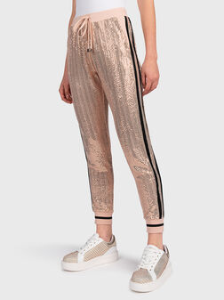 Slim fit trousers with appliqued rhinestones - 1