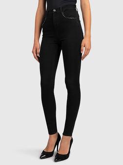 Черни дънки с капси - 1
