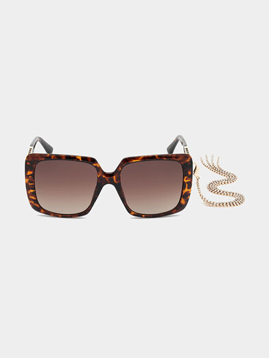 Sun glasses with brown frames and metal detail - 6