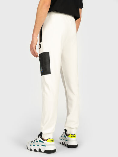 Sports pants with contrasting pocket - 4